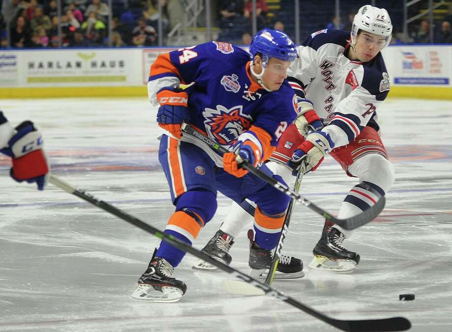 The Bridgeport Sound Tigers' Travis St. Denis carries the puck in front of the Hartford Wolf Pack's Filip Chytil on Feb. 18 at Webster Bank Arena in Bridgeport. The Bridgeport Sound Tigers and Hartford Wolf Pack have scheduled a home-and-home preseason series for late September, including a game at Webster Bank Arena before their parent clubs meet in an exhibition game. Photo: Brian A. Pounds / Hearst Connecticut Media / Connecticut Post