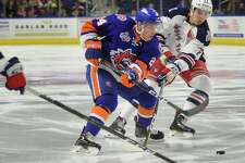 The Bridgeport Sound Tigers' Travis St. Denis carries the puck in front of the Hartford Wolf Pack's Filip Chytil on Feb. 18 at Webster Bank Arena in Bridgeport. The Bridgeport Sound Tigers and Hartford Wolf Pack have scheduled a home-and-home preseason series for late September, including a game at Webster Bank Arena before their parent clubs meet in an exhibition game.