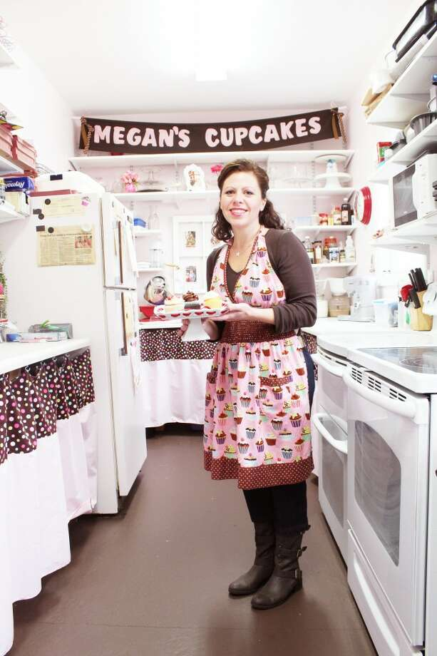 ONE-WOMAN OPERATION: Bridget Coffey, of Cadillac, started Megan's Cupcakes in 2008. She caters events and parties across Northern Michigan, offering delivery service and a variety of tastes. (Herald Review photos/Sarah Neubecker)