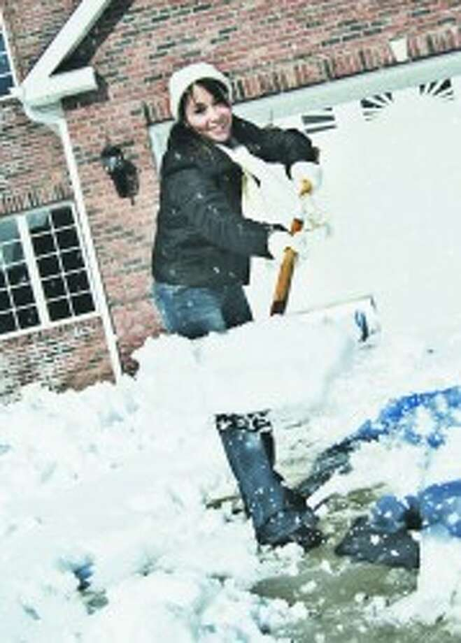 Winter chores: Avoid injury while completeting this traditional snowy chore. (Courtesy photo)