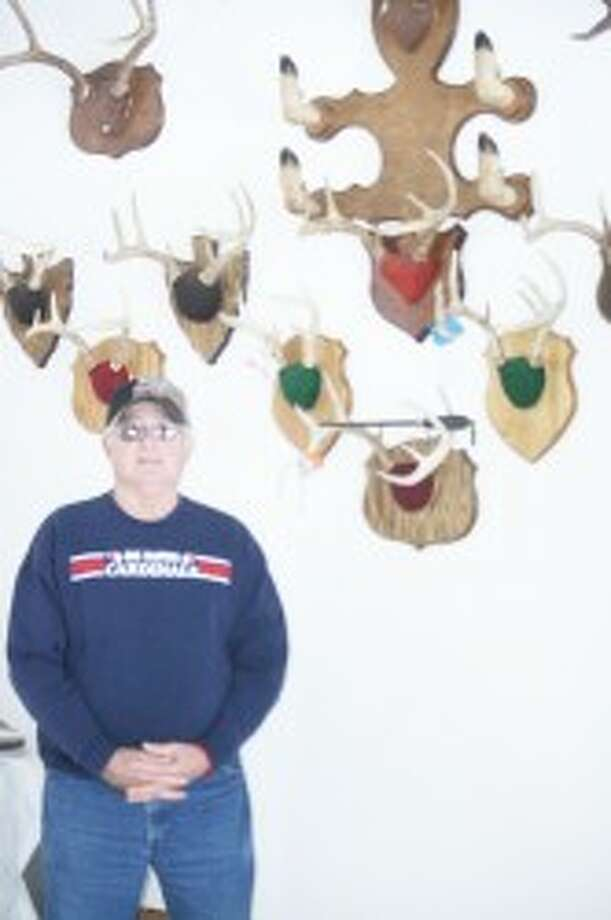 Trophies: Dave Robinson, with his many hunting trophies. (John Raffel/Herald Review photo)