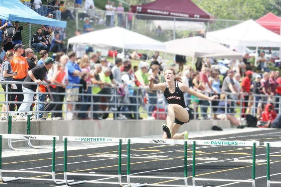 Number One moment: Sami Michell clears the hurdles on her way to victoory in the 300 meters at the Division 3 state finals. (File photo)