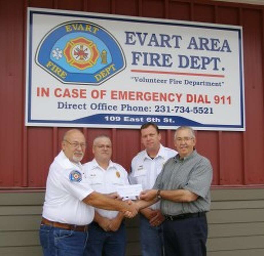 GRANTED FUNDS: The Evart Area Joint Fire Department received a $2,500 grant from FM Global to be used for pre-fire planning. Pictured (from left) is Evart Area Joint Fire Department Deputy Chief Ralph Carlson, Captain Jason Ackett, Assistant Chief Dan Kleeves and FM Global Representative John Lohmeyer. (Courtesy photo)