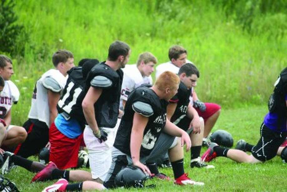 PREPARATIONS: Reed City football players get ready for a recent practice. (Herald Review photo/John Raffel)