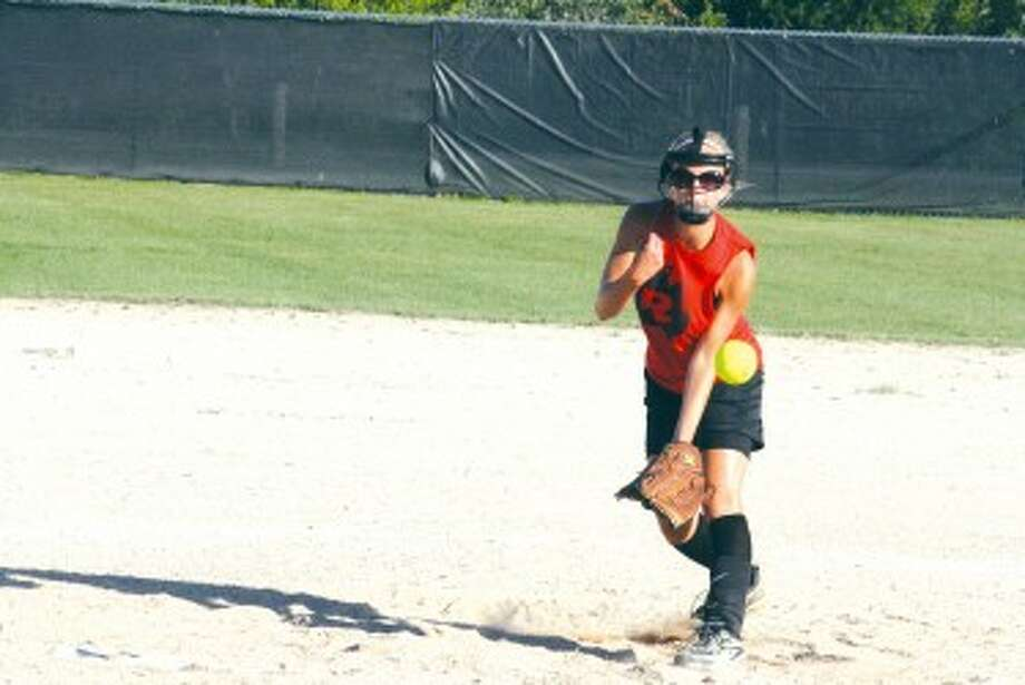 COMING IN FAST: Hannah Price of Reed City delivers a pitch against Pine River. (Herald Review photo/John Raffel)