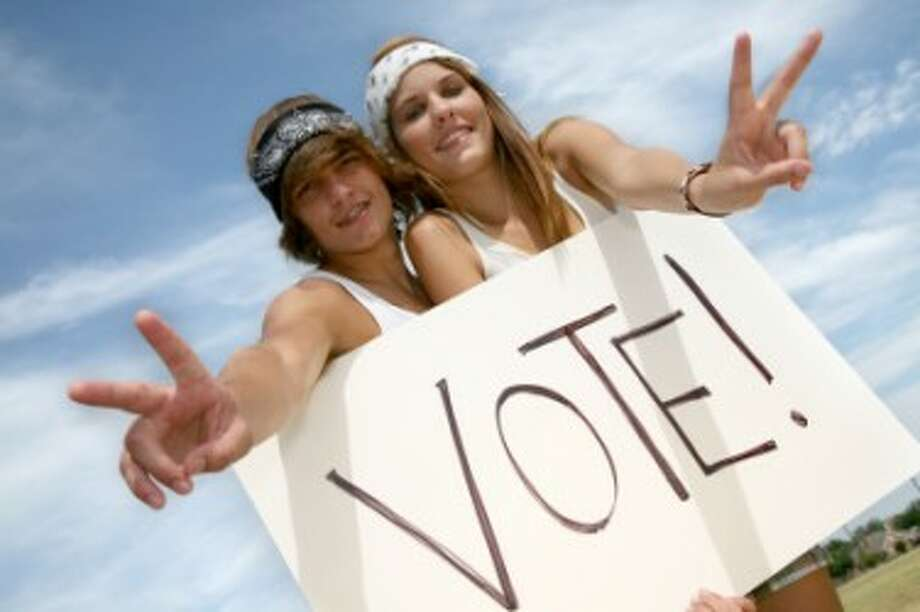 YOUNG VOTERS: New program allows college students who are unable to return home an opportunity to vote. (Courtesy photo)