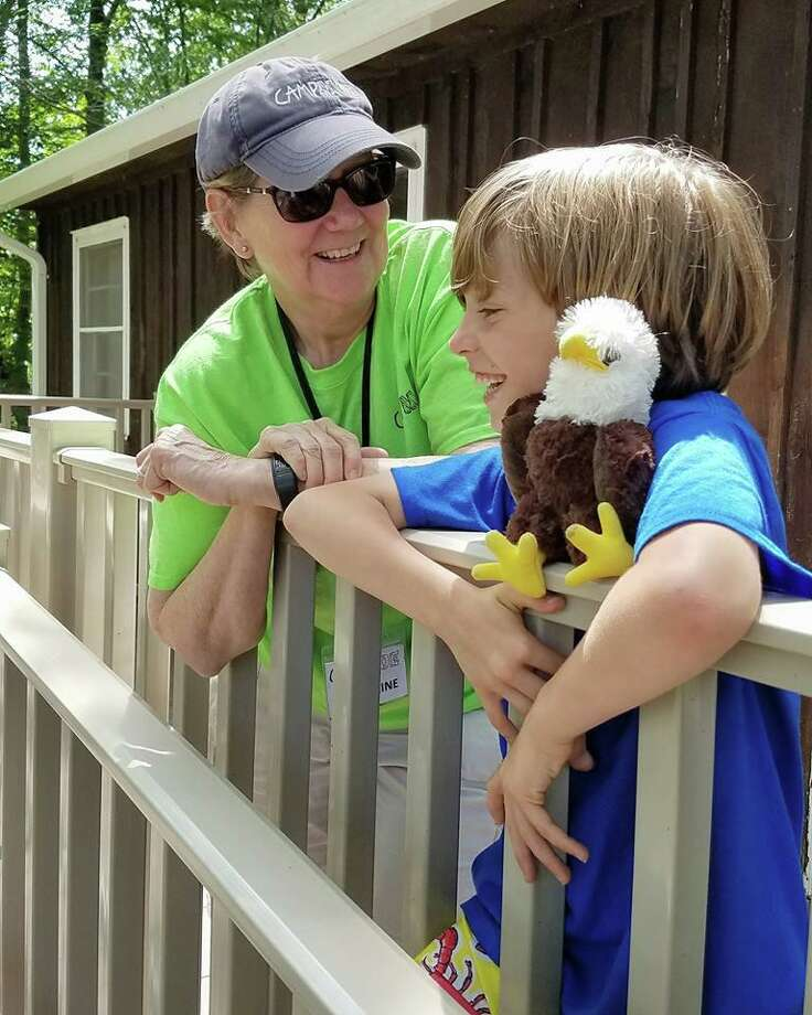 Katherine Marchand-Beyer, who retired this year as the longtime director of LARC's Camp MOE, shares a moment with Cash DeRienzo in the summer of 2017, shortly after he started at the camp for the first time. Photo: Photo Courtesy Of Camp Moe /