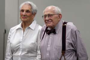 Former Times Union editor Harry M. Rosenfeld stands with his wife, Annie, while being honored during a party to celebrate his 90th birthday on Monday, Aug. 19, 2019,  at the Hearst Media Center in Colonie, N.Y. (Will Waldron/Times Union)