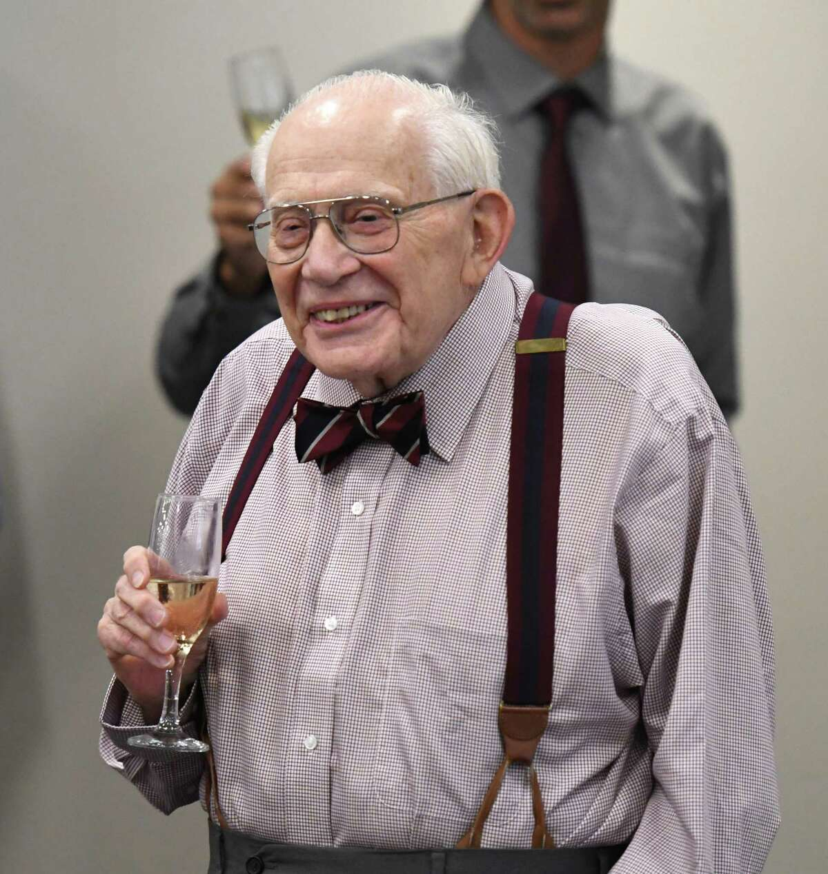Former Times Union editor Harry M. Rosenfeld is honored by Publisher George R. Hearst III during a party to celebrate Rosenfeld's 90th birthday on Monday, Aug. 19, 2019, at the Hearst Media Center in Colonie, N.Y. (Will Waldron/Times Union)