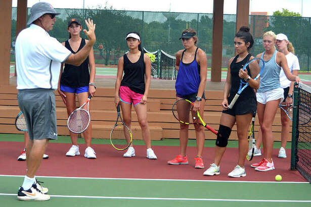 Edwardsville girls tennis coach Dave Lipe talks to his players during practice on Monday. Most of the EHS players were ball kids or interns in the Edwardsville Futures professional tournament just before tryouts started on Aug. 12.