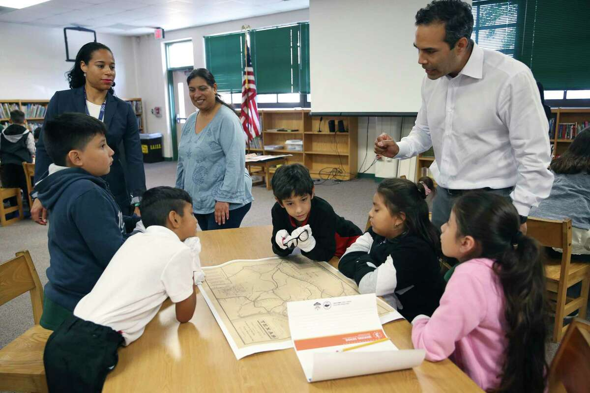 Texas Land Commissioner George P. Bush, right, talks with students as he teaches a Texas history lesson to fourth-graders at Storm Relay Lab Elementary School on Monday. The students are from left, Marcos Almendariz, 9, Isaac Martinez, 10, Dante Barrera, 9, Leeona Jaramillo, 9, and Jayleen Ojeda, 9. In back on the left is Principal Fellow Marissa Marchan and GEC Assistant Rosalinda Flores.