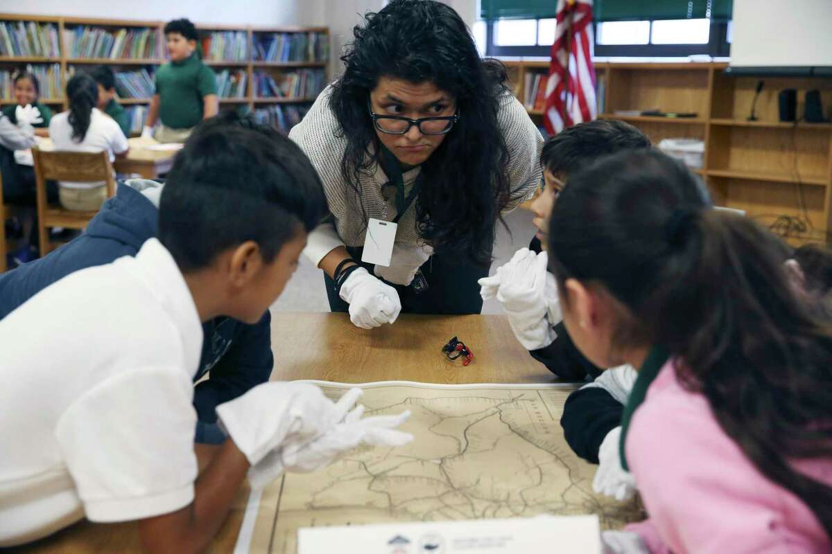 Fourth grade teacher Jennifer Cruz engages her students during a Texas history lesson at Storm Relay Lab Elementary School on Monday. Texas Land Commissioner George P. Bush gave a lesson to two fourth grade classes at the school and later visited Hillcrest Elementary, bringing copies of an 1887 Texas railroad system map and a Mexican Army cannonball that is thought to date back to the Battle of the Alamo.