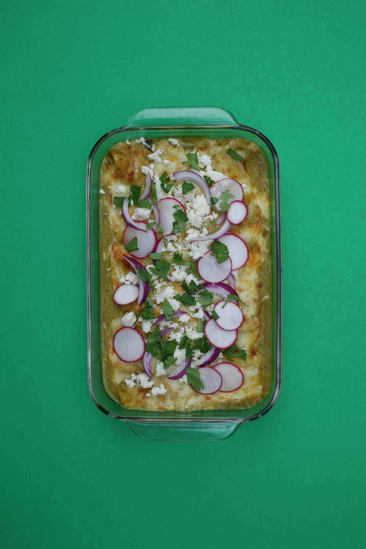 Green Chicken Enchiladas are made with rotisserie chicken and a quick sauce of canned enchilada sauce and tomatillo salsa.