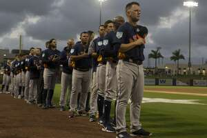 Houston Astros manager AJ Hinch (14) leads the team during National Anthem at the first spring training game against Washington Nationals at Fitteam Ballpark of The Palm Beaches on Saturday, Feb. 23, 2019, in West Palm Beach.