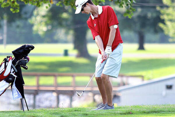 Roxana's Matt Marcuzzo hits a short chip onto the green on hole No. 1 at Belk Park on Monday morning in East Alton-Wood River's Hickory Stick Invitational boys golf tournament in Wood River.