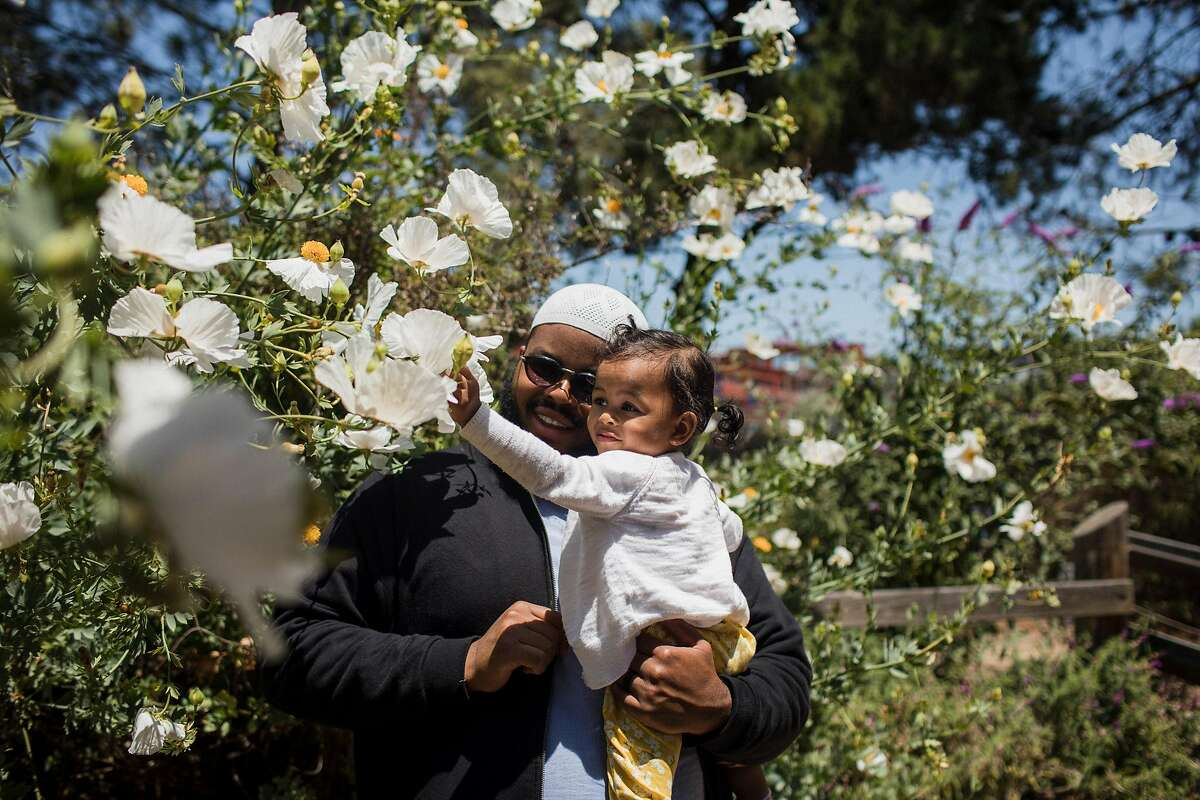 Ibraheem Basir, owner of A Dozen Cousin, and his two year old daughter on June 17, 2019 in Berkeley, California. The company's inspiration and recipes are not rooted solely in Basir's DNA, but rather in the black and brown community he grew up in.