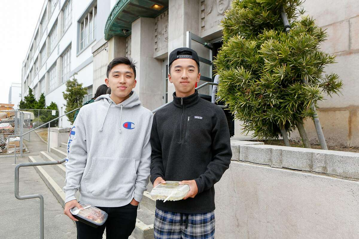 """(L to R) Kevin Wong, 18, and Morrison Szeto, 19, stand for a portrait outside of George Washington High School on Monday, August 19, 2019 in San Francisco, Calif. Both friends are opposed to removing the controversial mural, """"Life of Washington""""."""