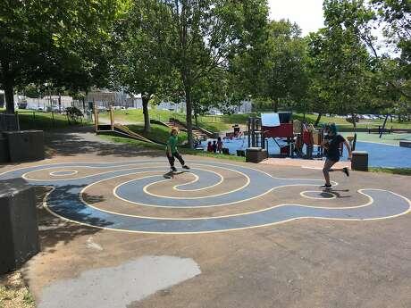 P oppy Allen, 9, (right) and Lincoln Allen, 7, at Potrero Del Sol playground. Photo: Mc Allen