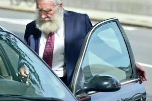 In this file photo, Rabbi Daniel Greer, then 77, of New Haven, leaves New Haven Superior Court on Elm Street in New Haven, Conn. Monday, August 14, 2017.