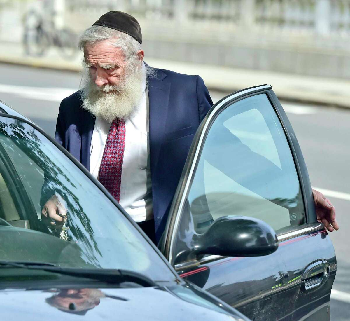 Rabbi Daniel Greer, then 77, of New Haven, leaves New Haven Superior Court on Elm Street in New Haven, Conn. Aug. 14, 2017 after he was arraigned.