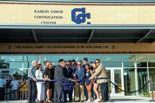 Central Catholic students, alumni and supporters cheer as the ribbon is cut on the newly opened 40,000-square-foot Kahlig-Cowie Convocation Center. A dedication ceremony was held Saturday.