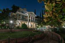 The Haunted Mansion in New Orleans Square at Disneyland Park is the home of 999 happy haunts, but there is always room for one more as guests take a spirited tour aboard their doom-buggy. During the tour, guests glide past a rattling casket in the conservatory, head off to Madame Leota's spooky séance room, float by the Grand Ballroom and its waltzing apparitions, then take a spin through a cemetery. The Haunted Mansion at Disneyland Park in Anaheim, Calif., opened on Aug. 9, 1969.