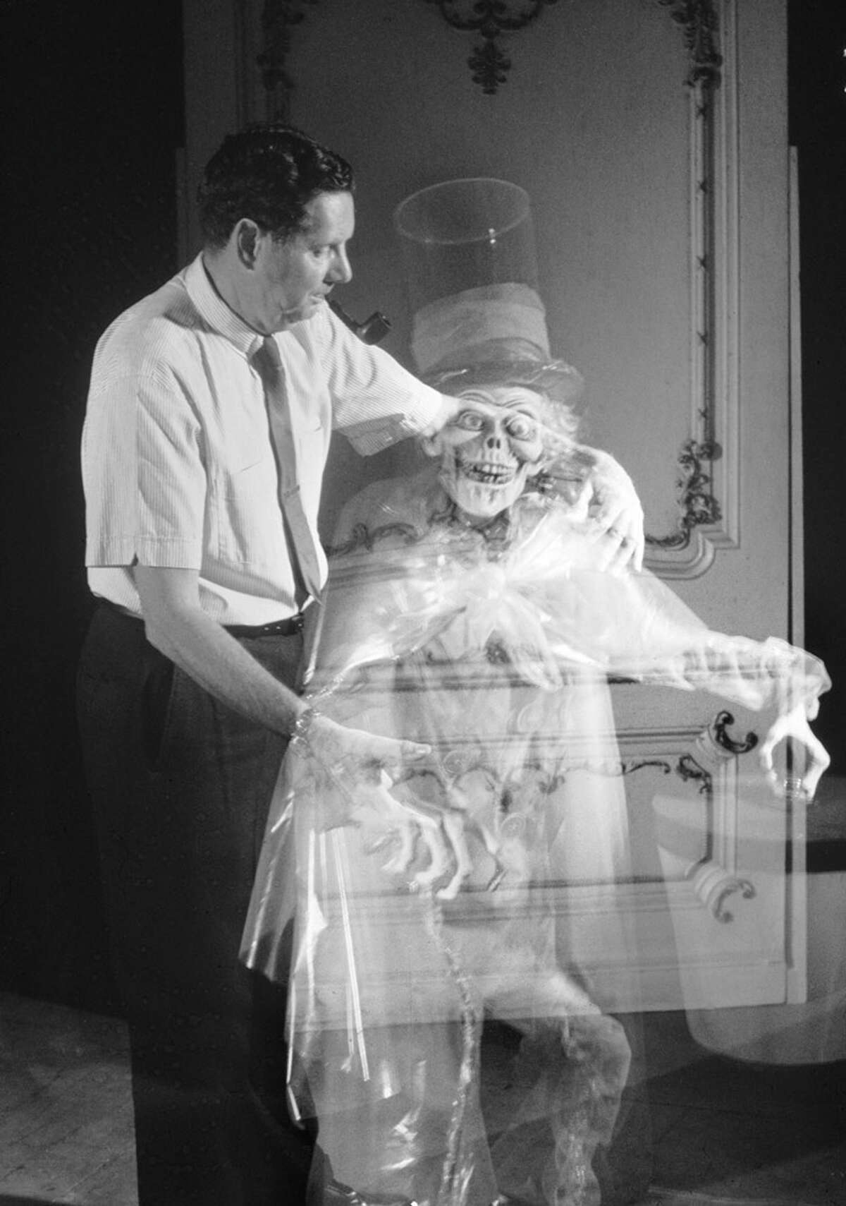 The Hatbox Ghost, pictured here with an Imagineer, originally occupied an attic scene with the bride. He was removed just a few days after opening, as Imagineers became convinced the scene just wasn't working. The ghost was reintroduced to the ride in 2015.