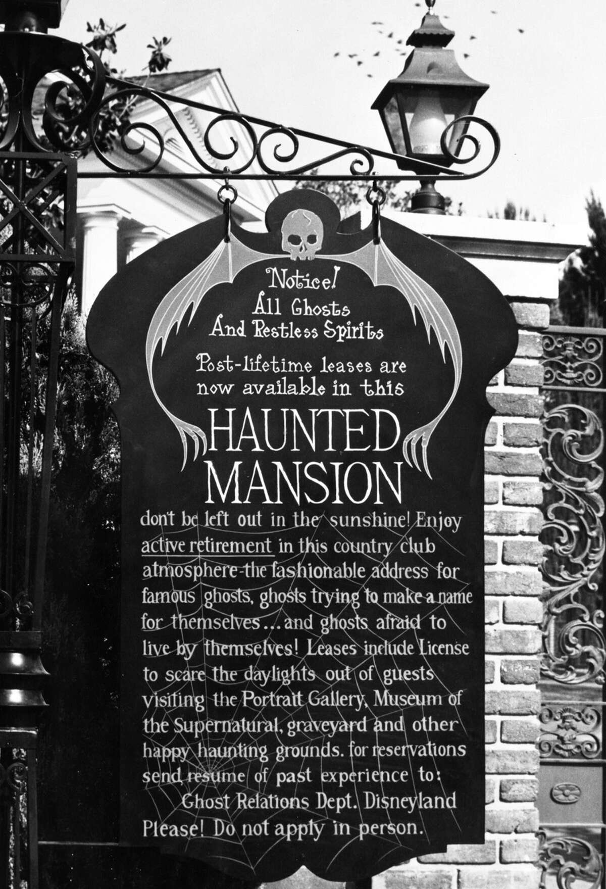 Fifty years ago, in 1969, before the Haunted Mansion opened to guests at Disneyland Park in Anaheim, Calif., a witty sign displayed outside of the attraction read,