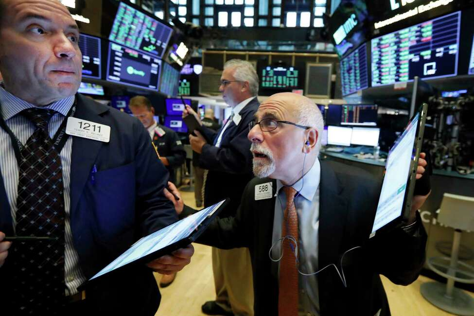 Traders Tommy Kalikas, left, and Peter Tuchman work on the floor of the New York Stock Exchange, Monday, Aug. 19, 2019. Technology stocks were leading indexes higher on Wall Street after the U.S. gave Chinese telecom giant Huawei another 90 days to buy equipment from American suppliers. (AP Photo/Richard Drew)