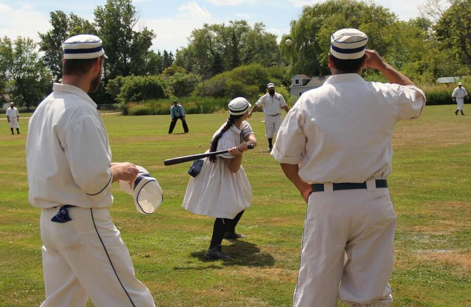 Players from the Richmond Bees and the Early Riser Base Ball Club faced off in a friendly game of base ball, a vintage variation on America's pastime, during ABC Day in Port Hope Saturday. Photo: Mark Birdsall/Huron Daily Tribune