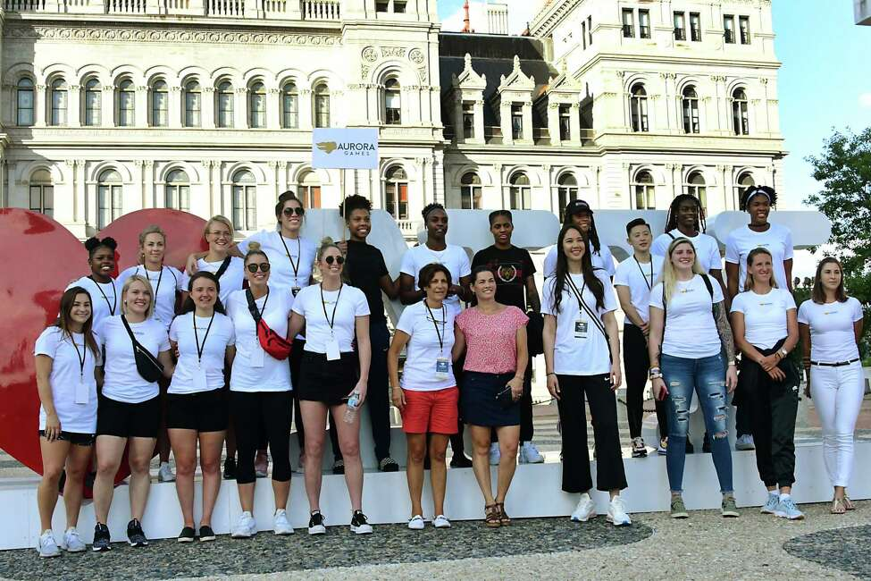 Athletes get their photo taken at the I love NY statue before marching to the stage as part of the official Aurora Games kickoff ceremony at the Empire State Plaza on Monday, Aug. 19, 2019 in Albany, N.Y. (Lori Van Buren/Times Union)
