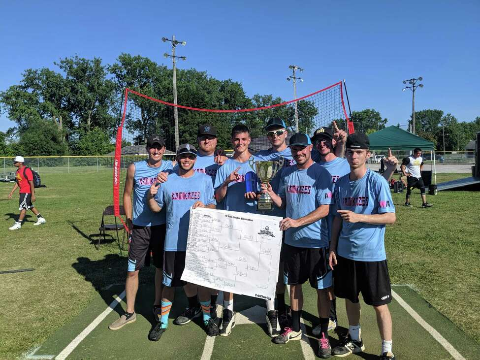 The Blue Kamikazes pose after winning their national title in Wiffle ball in Michigan. Team members are, from left, Jim Cole, Mike VanNostrand, Brett DeLano, Anthony LaValley, Vin Lea, Nate Cruz, Kyle VonScheusingen, and Tom Gannon.