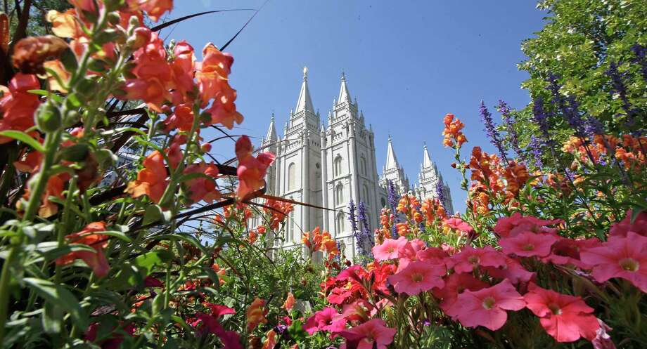 FILE - This Aug. 4, 2015 file photo, flowers bloom in front of the Salt Lake Temple, at Temple Square, in Salt Lake City. The Church of Jesus Christ of Latter-day Saints is reminding members that coffee is prohibited no matter how fancy the name, that vaping is banned despite the alluring flavors and that marijuana is outlawed unless prescribed by a competent doctor. (AP Photo/Rick Bowmer, File) Photo: Rick Bowmer, STF / Associated Press / Copyright 2019 The Associated Press. All rights reserved.