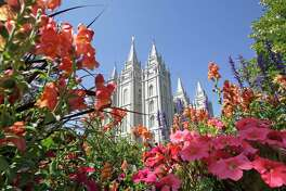 FILE - This Aug. 4, 2015 file photo, flowers bloom in front of the Salt Lake Temple, at Temple Square, in Salt Lake City. The Church of Jesus Christ of Latter-day Saints is reminding members that coffee is prohibited no matter how fancy the name, that vaping is banned despite the alluring flavors and that marijuana is outlawed unless prescribed by a competent doctor. (AP Photo/Rick Bowmer, File)