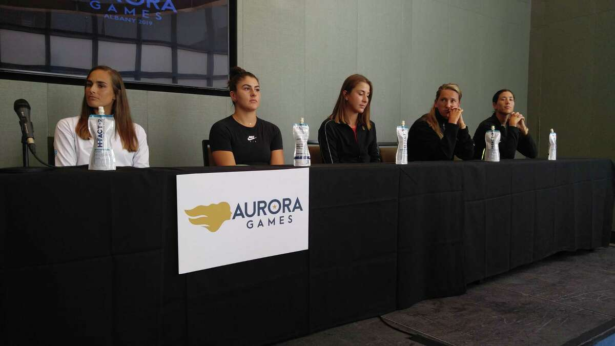 Aurora Games tennis players, from left, Monica Puig (Puerto Rico), Bianca Andreescu (Canada), Belinda Bencic (Switzerland), Victoria Azarenka (Belarus) and Garbine Muguruza (Spain) speak Monday, Aug. 19, 2019, at Albany Capital Center during a press conference for the Aurora Games. (Pete Dougherty / Times Union)