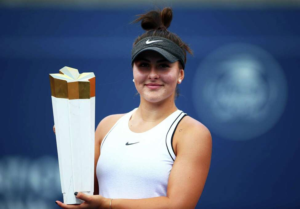 TORONTO, ON - AUGUST 11: Bianca Andreescu of Canada with the winners trophy following her victory over Serena Williams of the United States in the final match on Day 9 of the Rogers Cup at Aviva Centre on August 11, 2019 in Toronto, Canada. Williams withdrew from the match with a back injury. (Photo by Vaughn Ridley/Getty Images)