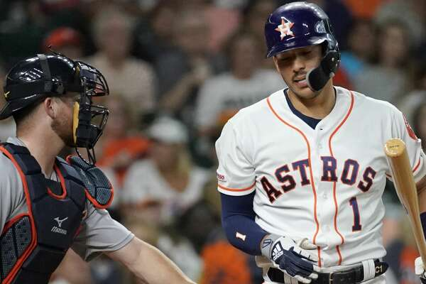 Detroit Tigers catcher Jake Rogers tags Houston Astros Carlos Correa after he strikes out swinging during the first inning of MLB game at Minute Maid Park Monday, Aug. 19, 2019, in Houston.