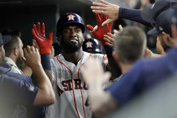 Houston Astros Yordan Alvarez celebrates in dugout after he scored on a double hit by Yuli Gurriel against the Detroit Tigers during the first inning of MLB game at Minute Maid Park Monday, Aug. 19, 2019, in Houston. Alex Bregman also scored.