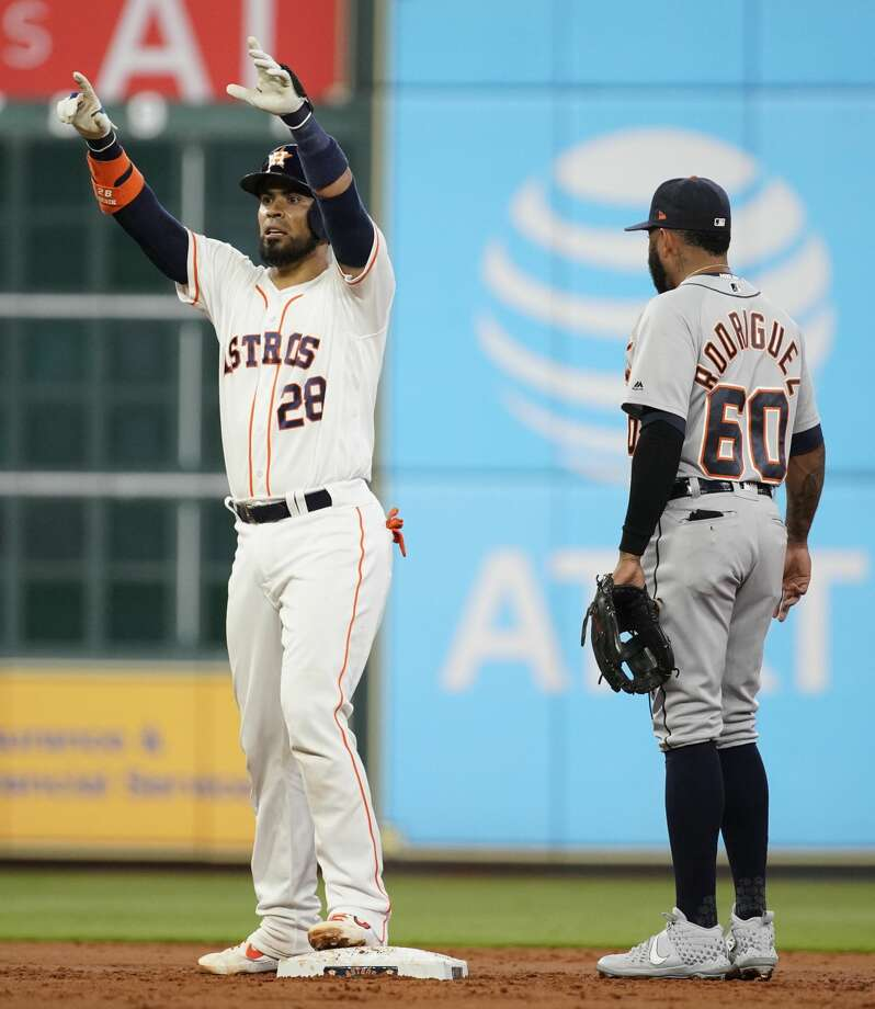 Houston Astros Robinson Chirinos raises his hands as he stands at second base with Detroit Tigers Ronny Rodriguez  during the first inning of MLB game at Minute Maid Park Monday, Aug. 19, 2019, in Houston.  Robinson Chirinos got to second base on a fielding error by left fielder Brandon Dixon. Photo: Melissa Phillip/Staff Photographer