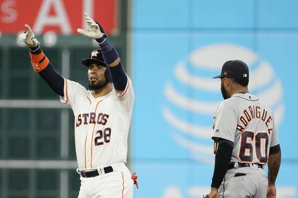 Houston Astros Robinson Chirinos raises his hands as he stands at second base with Detroit Tigers Ronny Rodriguez during the first inning of MLB game at Minute Maid Park Monday, Aug. 19, 2019, in Houston. Robinson Chirinos got to second base on a fielding error by left fielder Brandon Dixon.