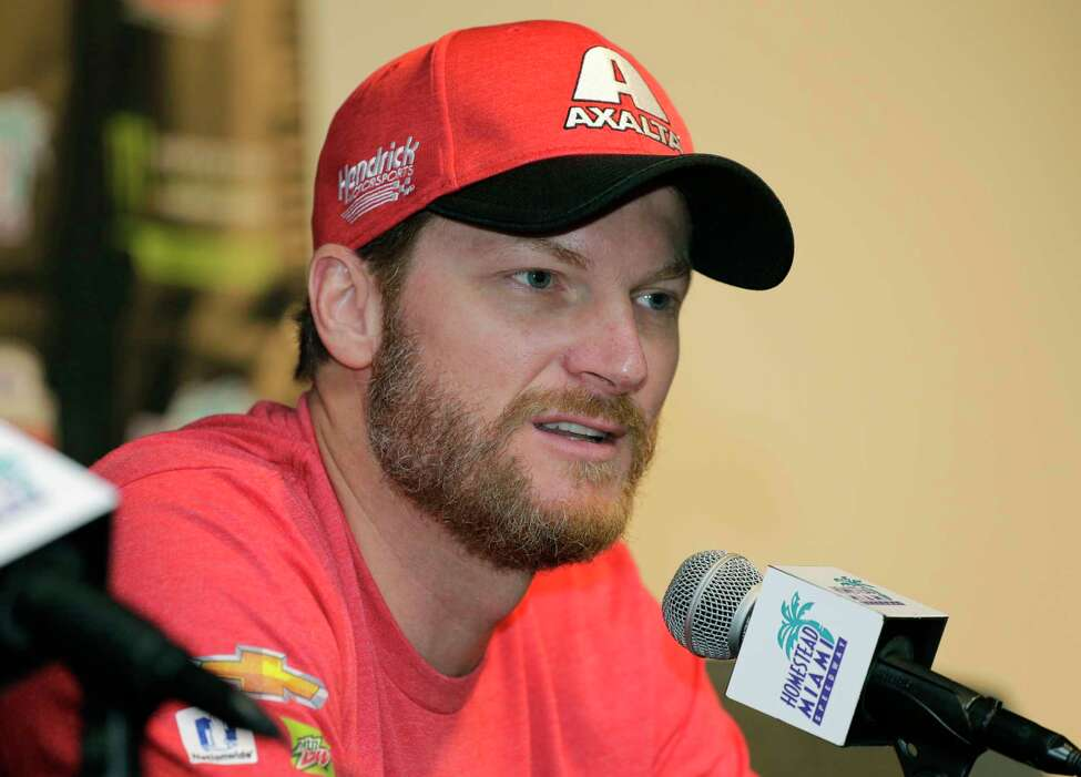 FILE - In this Nov. 17, 2017, file photo, Dale Earnhardt Jr. speaks with the media during a news conference before a NASCAR Cup Series auto race at Homestead-Miami Speedway in Homestead, Fla. Dale Earnhardt Jr. is ready to slide into the next phase of his NASCAR career, this time as a broadcaster. Earnhardt makes his anticipated debut in the NBC Sports booth this weekend at Chicagoland. (AP Photo/Terry Renna, File)