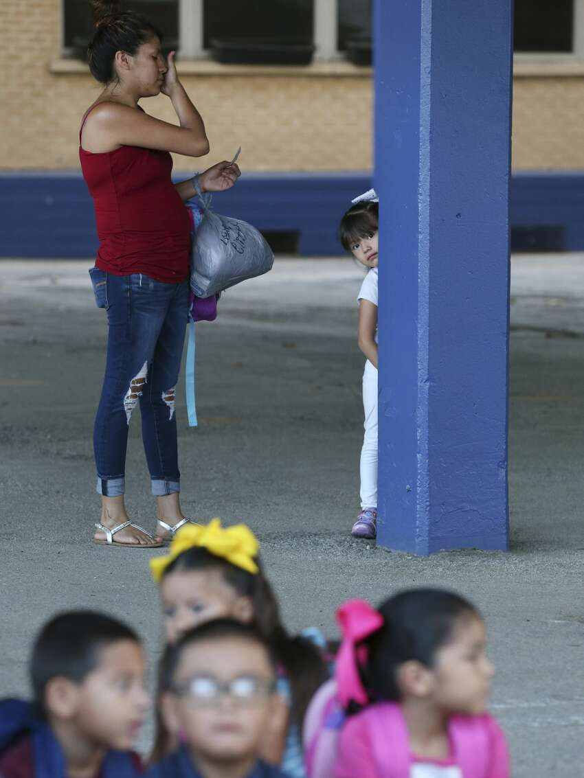 Lexie Elizondo, 4, refuses to join the rest of the pre-kinder students as her mother, Claudia Chavarria tries to coax her on the first day of classes at the newly reopened Athens Elementary School in the South San Independent School District, Monday, Aug. 19, 2019. Athens in one of three schools that were reopened in the district that also includes Kazen Middle School and West Campus. The district spent nearly $3 million in improvements at the schoolsl.