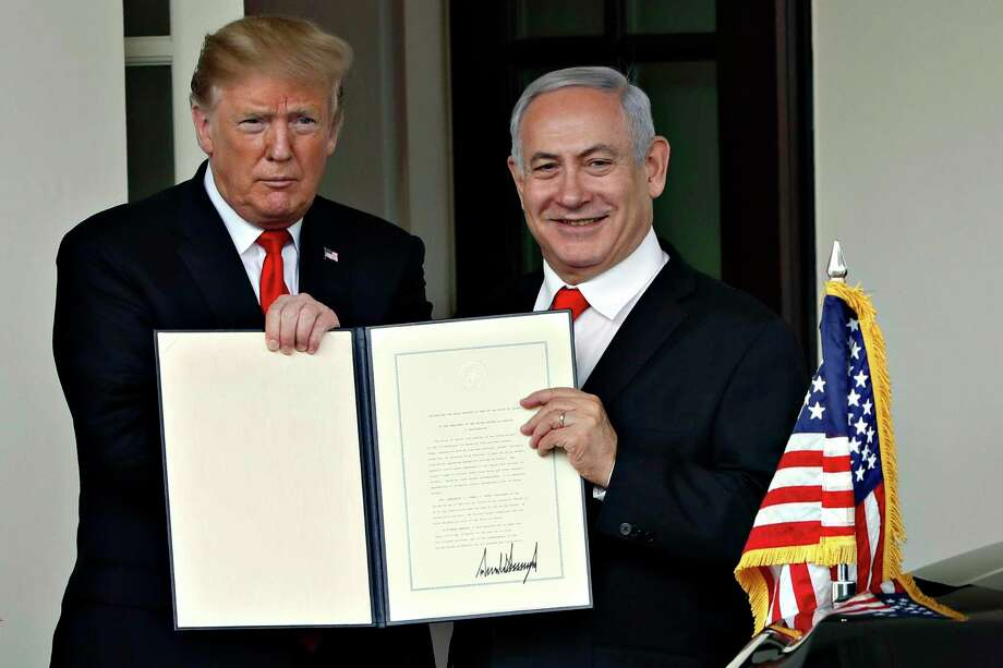 President Donald Trump and Israeli Prime Minister Benjamin Netanyahu hold up a signed proclamation, after their meeting in March. Trump — with the knowing help of Netanyahu — is doing something no American president and Israeli prime minister have done before: They're making support for Israel a wedge issue in American politics. Photo: Jacquelyn Martin /Associated Press / Copyright 2019 The Associated Press. All rights reserved.