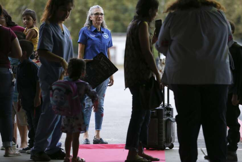 South San Antonio Independent School Board of Trustees President Connie Prado is on hand to greet students for the first day of classes at the newly reopened Athens Elementary School, Monday, Aug. 19, 2019. Athens in one of three schools that were reopened in the district that also includes Kazen Middle School and West Campus. The district spent nearly $3 million in improvements at the schools.
