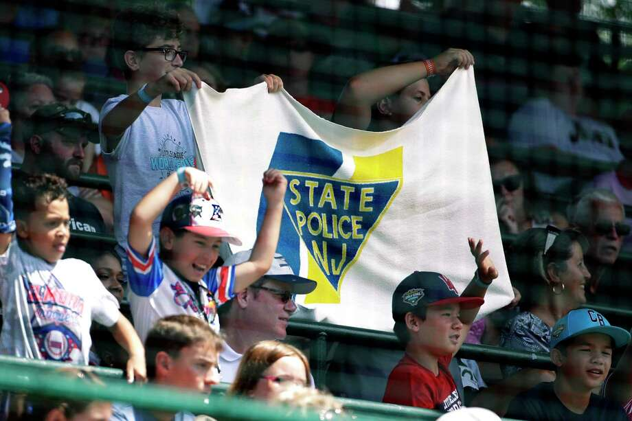 Elizabeth, New Jersey little league fans hold a banner during a baseball game between Elizabeth, N.J., and Wailuku, Hawaii, at the Little League World Series tournament in South Williamsport, Pa., Monday, Aug. 19, 2019. (AP Photo/Gene J. Puskar) Photo: Gene J. Puskar / Copyright 2019 The Associated Press. All rights reserved