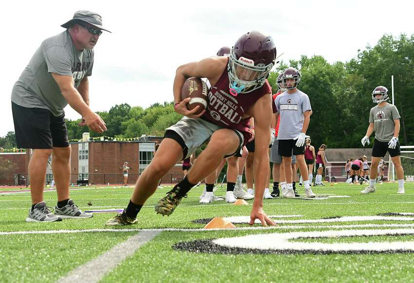 Assistant coach Rick Snyder, left, watches players perform a drill as the Burnt Hills-Ballston Lake football team holds its first practice on Monday, Aug. 19, 2019 in Burnt Hills, N.Y. (Lori Van Buren/Times Union)