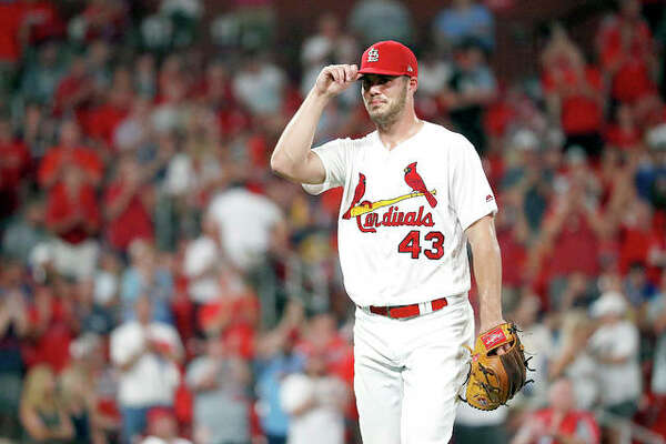 Cardinals starting pitcher Dakota Hudson tips his cap after being removed in the seventh inning of Monday night's game against the Milwaukee Brewers at Busch Stadium.