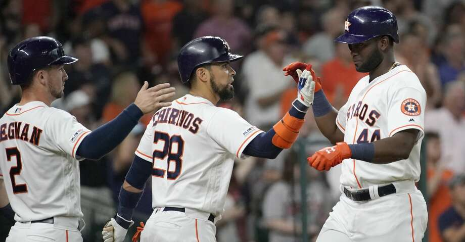 Houston Astros Alex Bregman, left, and Robinson Chirinos, center, celebrates with Yordan Alvarez, right, as he scores on a double hit by Yuli Gurriel against the Detroit Tigers during the first inning of MLB game at Minute Maid Park Monday, Aug. 19, 2019, in Houston.  Alex Bregman also scored. Photo: Melissa Phillip/Staff Photographer