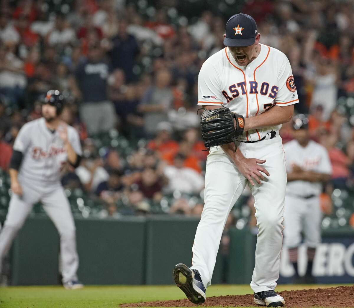 Houston Astros pitcher Will Harris reacts to striking out Detroit Tigers Travis Demeritte during the eighth inning of MLB game at Minute Maid Park Monday, Aug. 19, 2019, in Houston.
