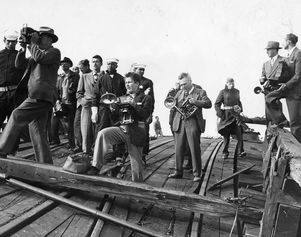 July 18, 1944: Photographers and reporters at the site of the Port Chicago munitions explosion. Virginia de Carvalho is in the foreground.